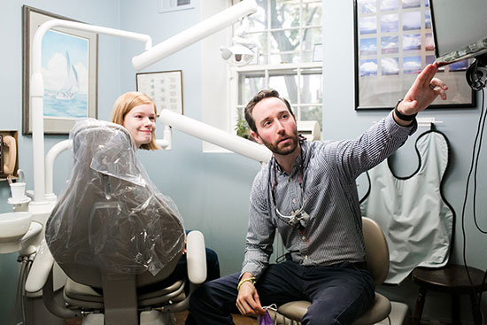 Dr. Patterson showing dental x-ray to a patient