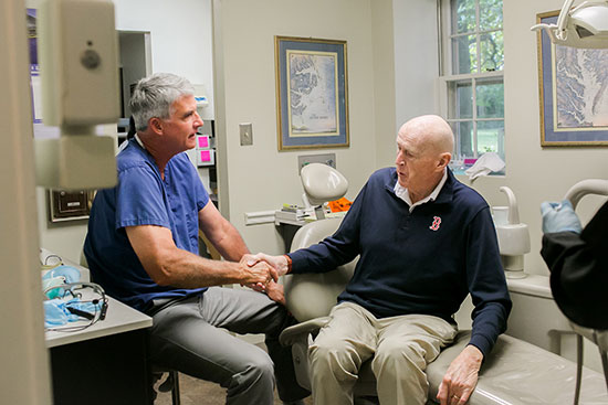 Dr. Williams at a consultation with a patient